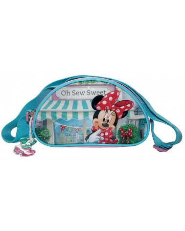 Sac bandoulière arrondi Minnie devant sa boutique